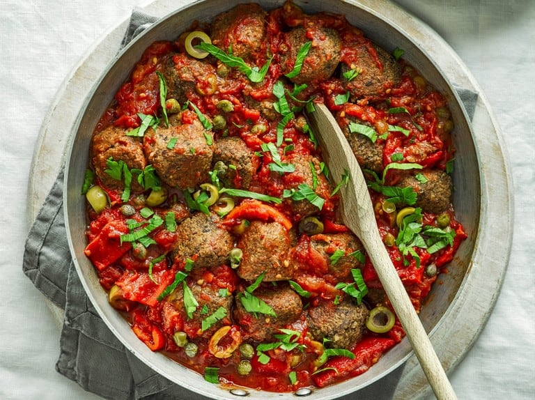 Veggie Meatballs with Tomatoes, Olives and Caper Sauce